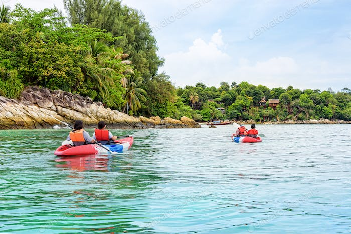 Tourist group are kayaking on the sea at Ko Lipe, Thailand