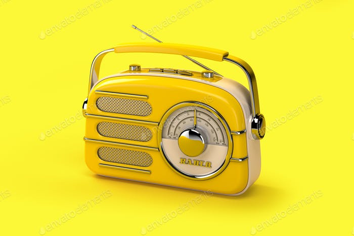 Yellow vintage radio on yellow background.