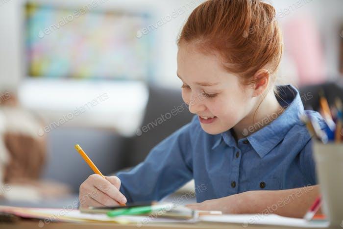 Red Haired Girl doing Homework