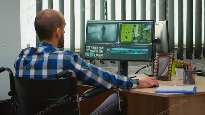 Disabled videographer editing a video project