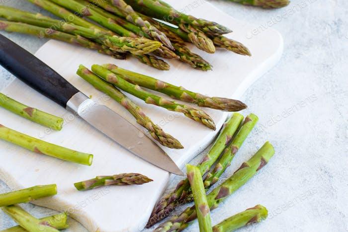 Fresh asparagus with a knife