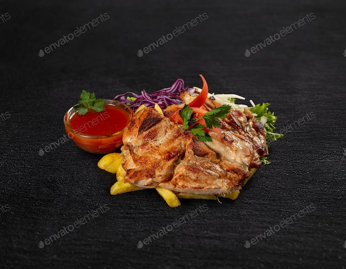 Grilled chicken, chips and cabbage salad
