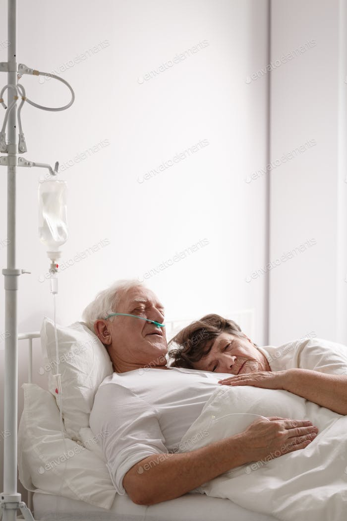 Dying husband in hospital bed