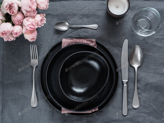Beautiful table setting on gray linen tablecloth