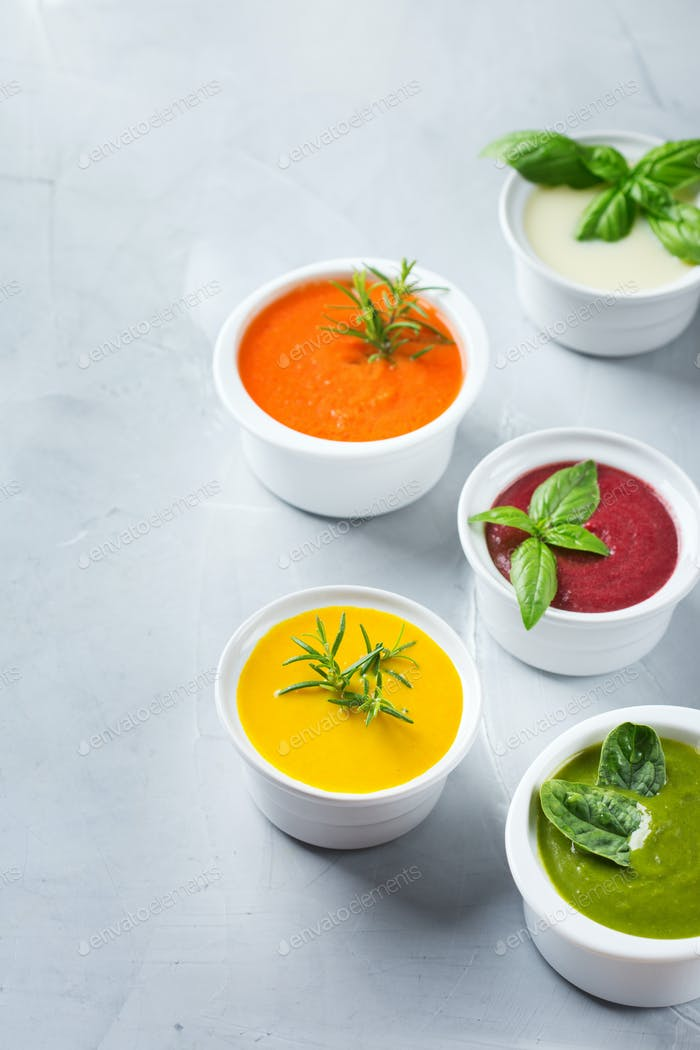 Set of seasonal fall autumn creamy soups on a table