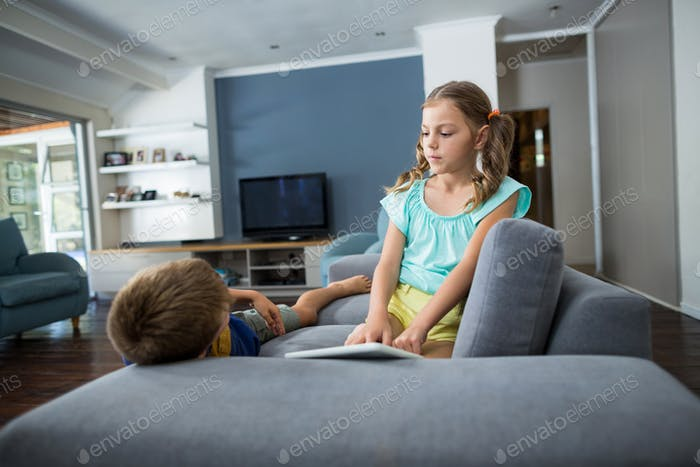 Siblings interacting with each other in living room