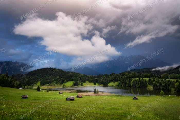 Geroldsee view during rainy day. Colorful cloudy sky. Bavarian A