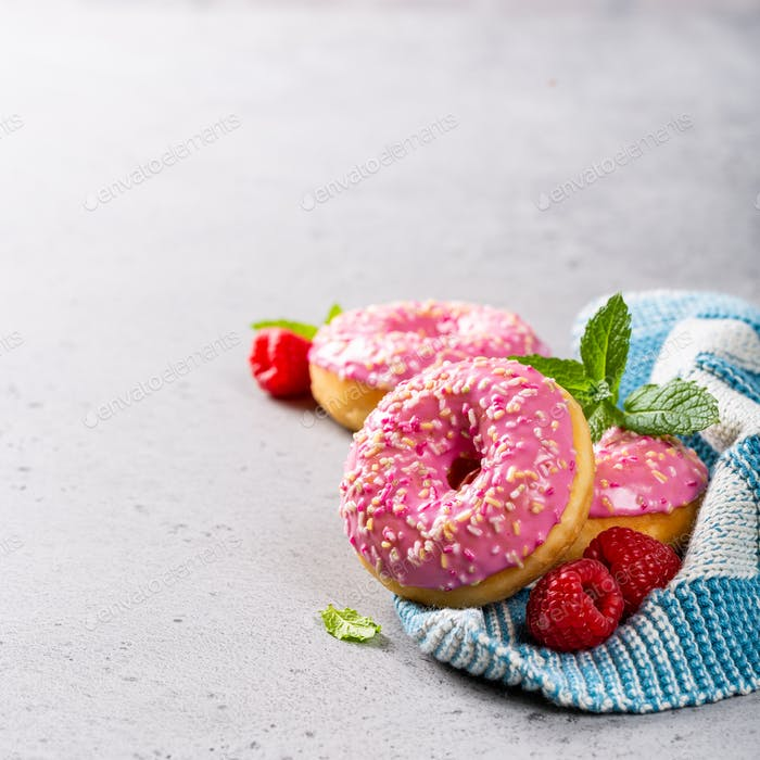 Pink donuts on gray background