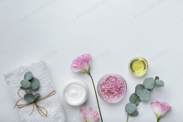Homemade rose extract cosmetics for spa and bath on white