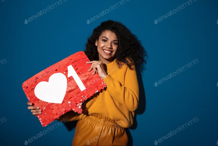 Happy african woman holding like symbol sign