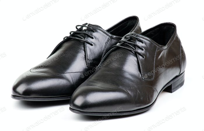 Pair of black male classic shoes over white