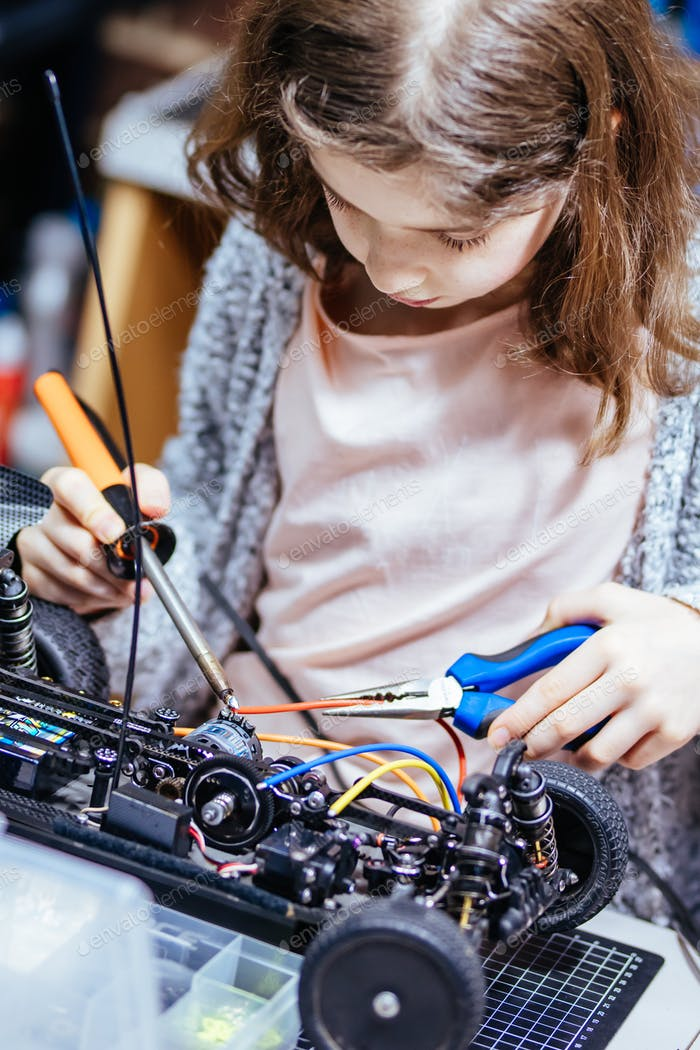 Young Girl Soldering a Model