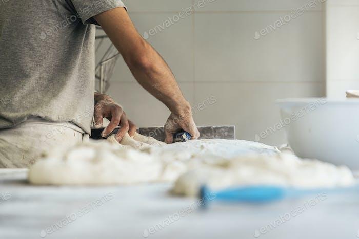Unrecognizable baker man working.