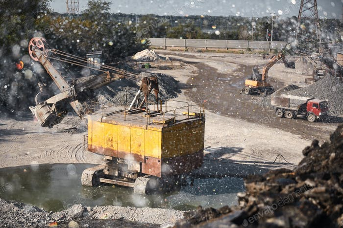 Quarry bucket excavator works in a slag dump