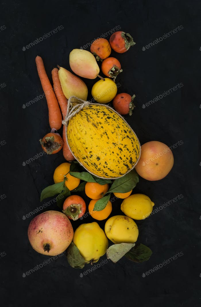 Mixed yellow orange fruit and veggies assortment, ingredients for smoothie