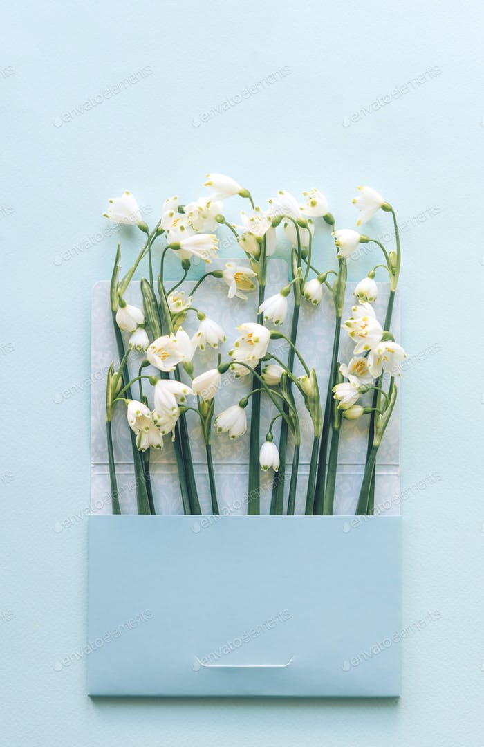 Spring fragrant letter with greetings and snowdrops
