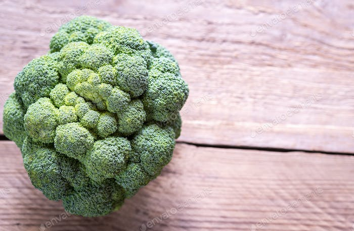 Fresh broccoli on the wooden background