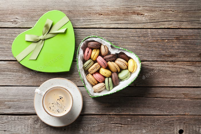 Macaroons in Valentines day gift box and coffee