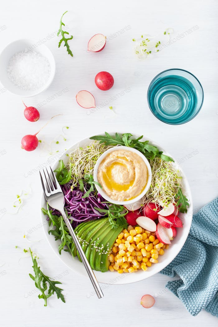 vegan avocado sweet corn lunch bowl with hummus, red cabbage, ra
