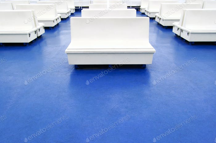 White seat or bench on a ferry boat as background