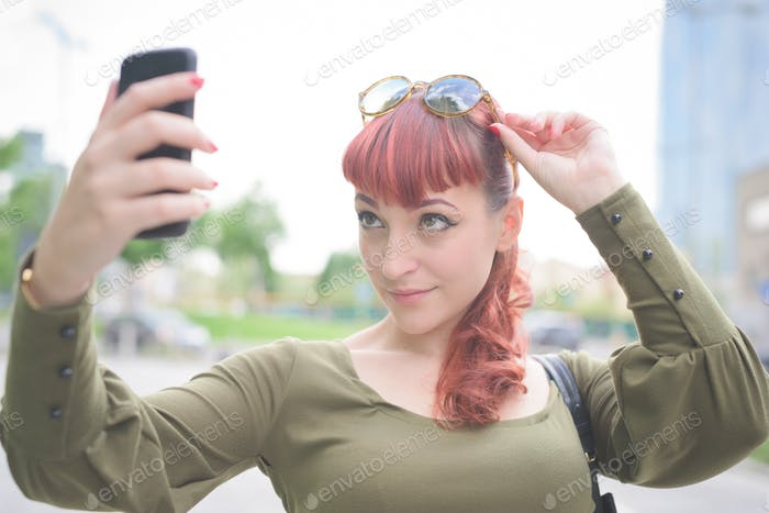 young handsome redhead woman taking selfie
