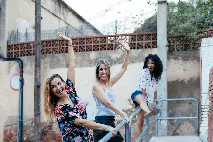 Three girls playing on the street