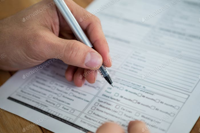Businesswoman filling last will and testament form
