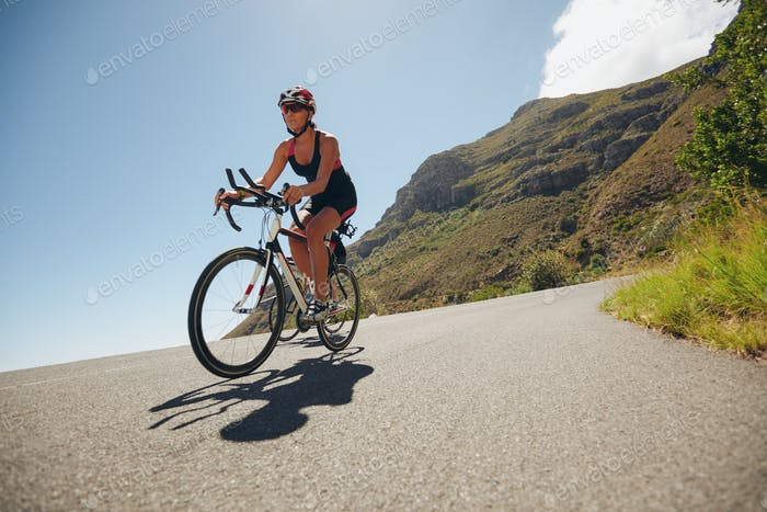 Woman competing in the cycling leg of a triathlon