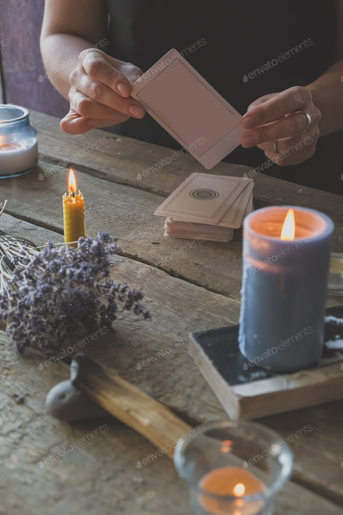 Tarot cards, Fortune telling on tarot cards at night by candlelight,