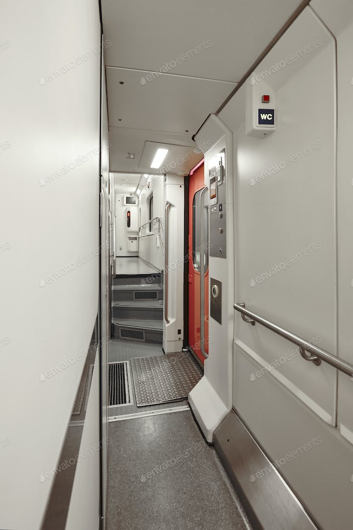 Sleeper wagon train corridor indoor. First floor. Transportation service. Vertical
