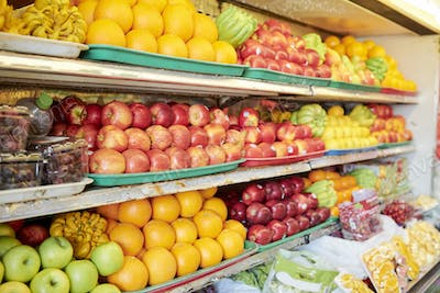 Shelves with fruits at grocery store