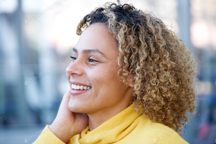 side portrait of happy african american woman with curly hair
