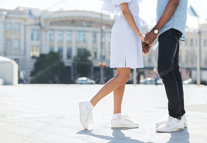 Male and female legs during date in city