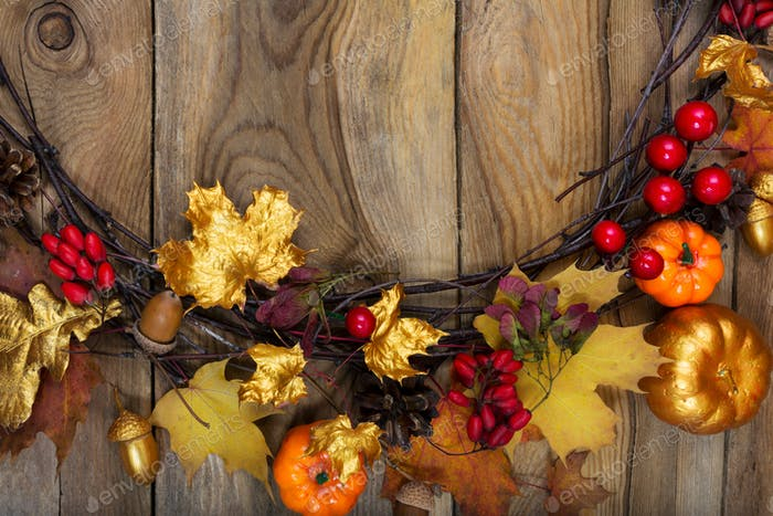 Thanksgiving background with golden pumpkin, acorn and maple lea