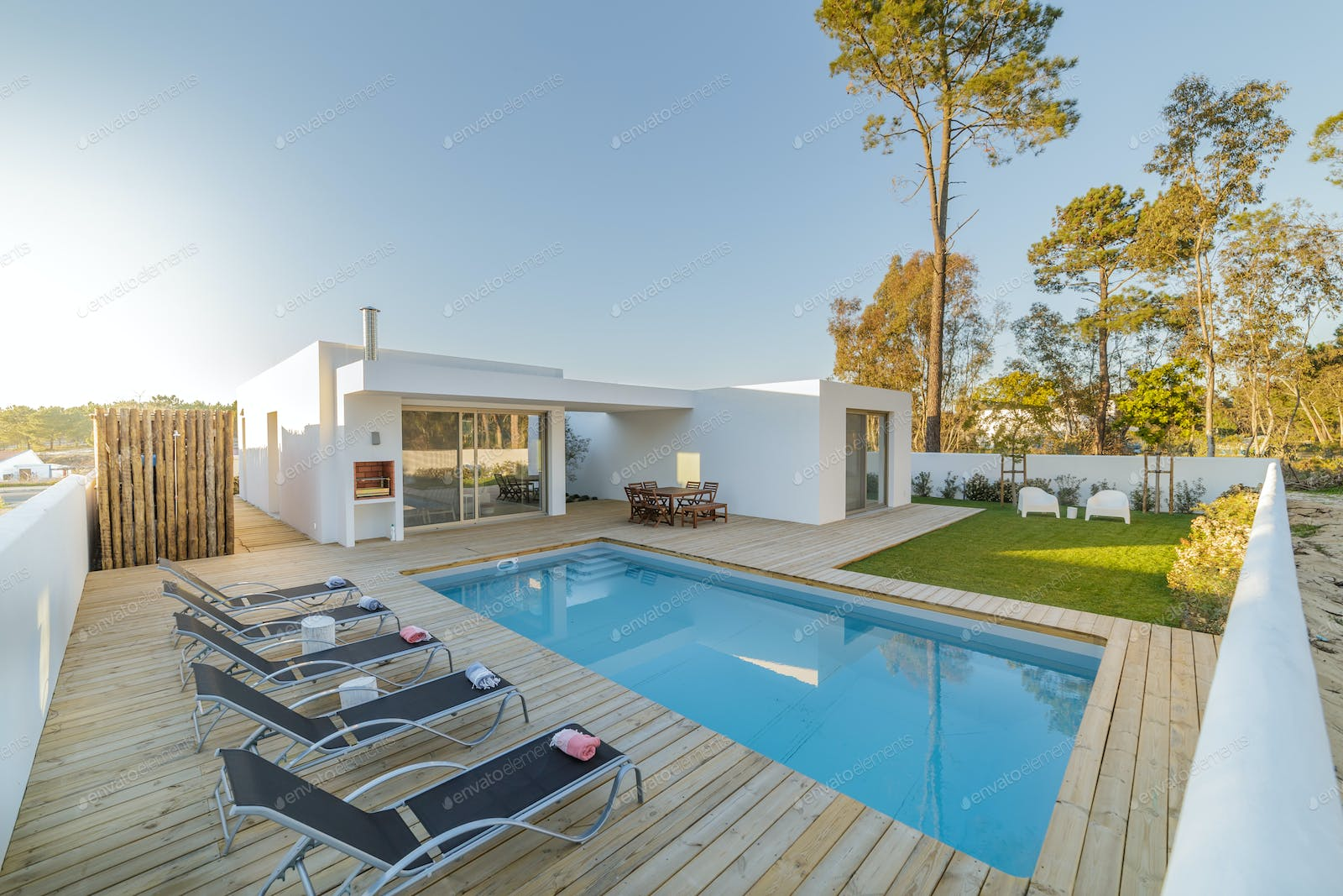 Garden With Swimming Pool modern house with garden swimming pool and wooden deck photo by luisviegas  on envato elements