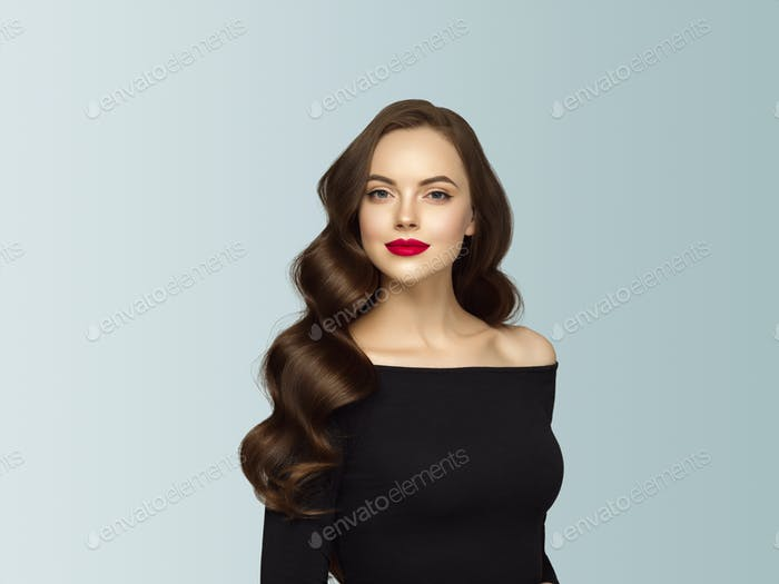 Beautiful hair woman with long brunette hair beauty healthy hairstyle. Gray background.