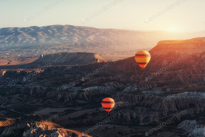 Amazing sunset over Cappadocia. Beautiful color balloons. Turkey