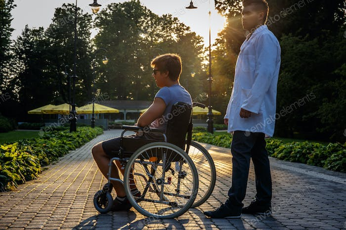 Young man in wheelchair.