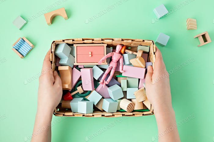 Flat lay with wooden blocks in pastel colors. Eco friendly, zero waste, plastic free, educational
