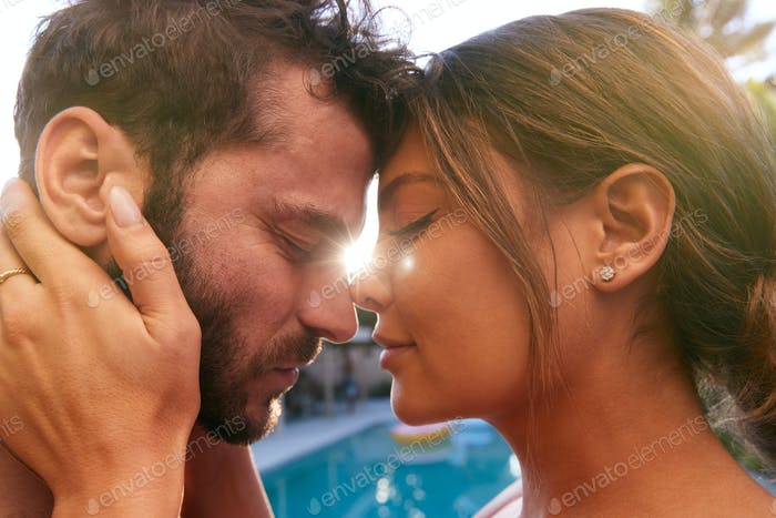 Romantic Hispanic Couple Outdoors Enjoying Summer Pool Party