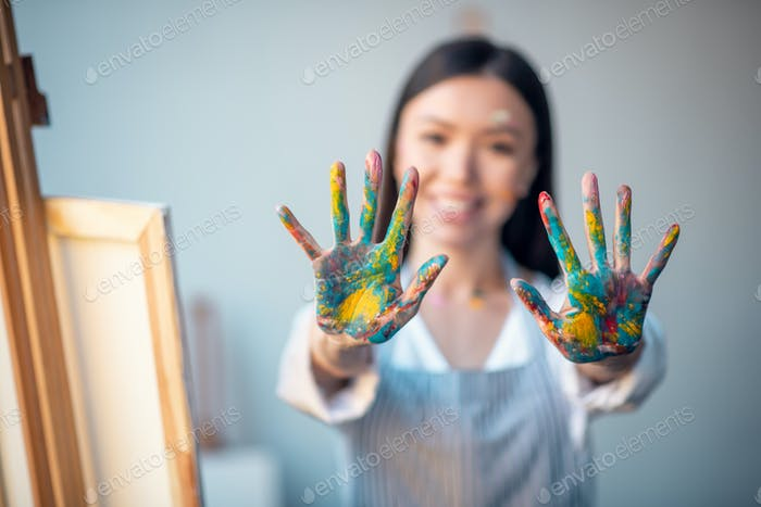 Hands of a good looking young woman