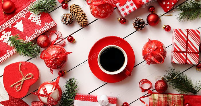 Christmas decorations and presents around coffee