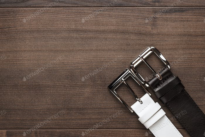 brown and white leather belts