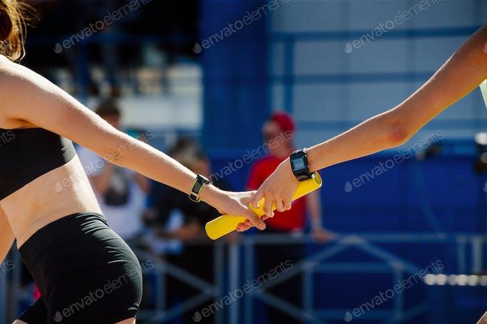 young women relay race