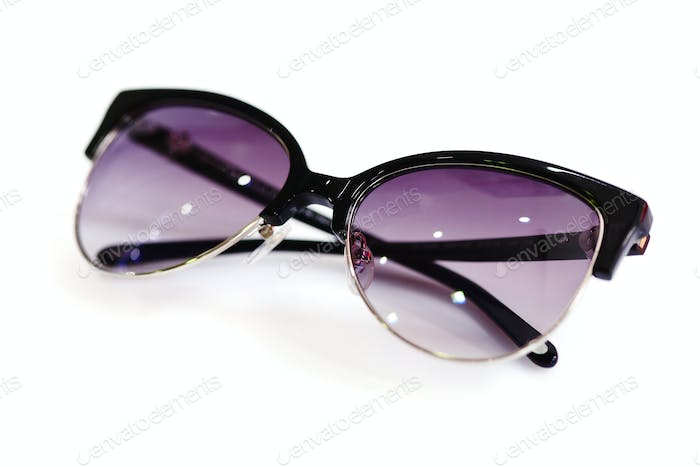 Stylish women's sunglasses on white background