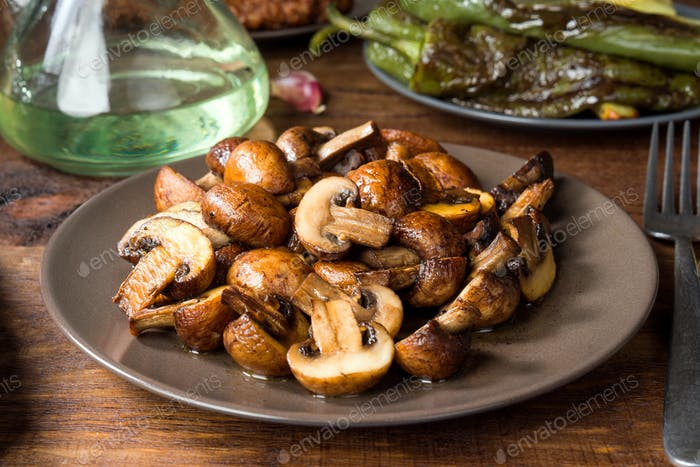cut barbecue mushrooms and other ingredients on rustic wood