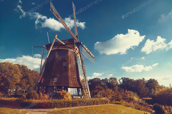 Amsterdam old windmill spin by wind blue sky