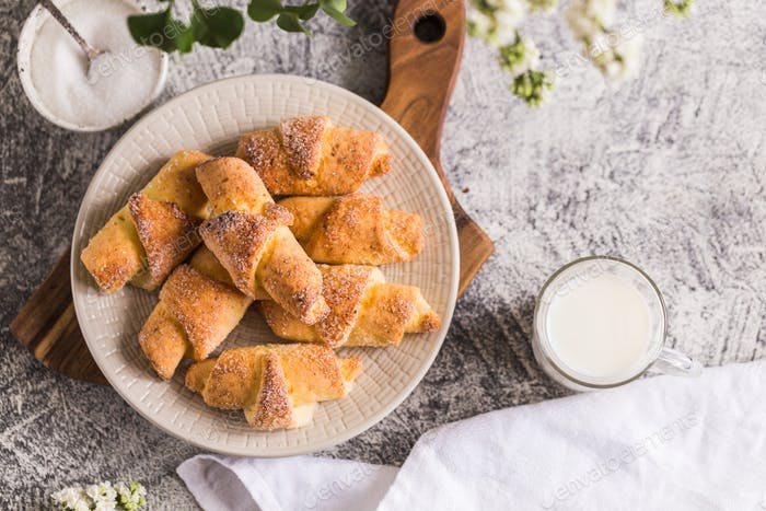 homemade cottage cheese mini croissants on a gray concrete background
