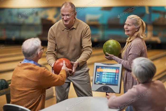 Senior People Enjoying Bowling