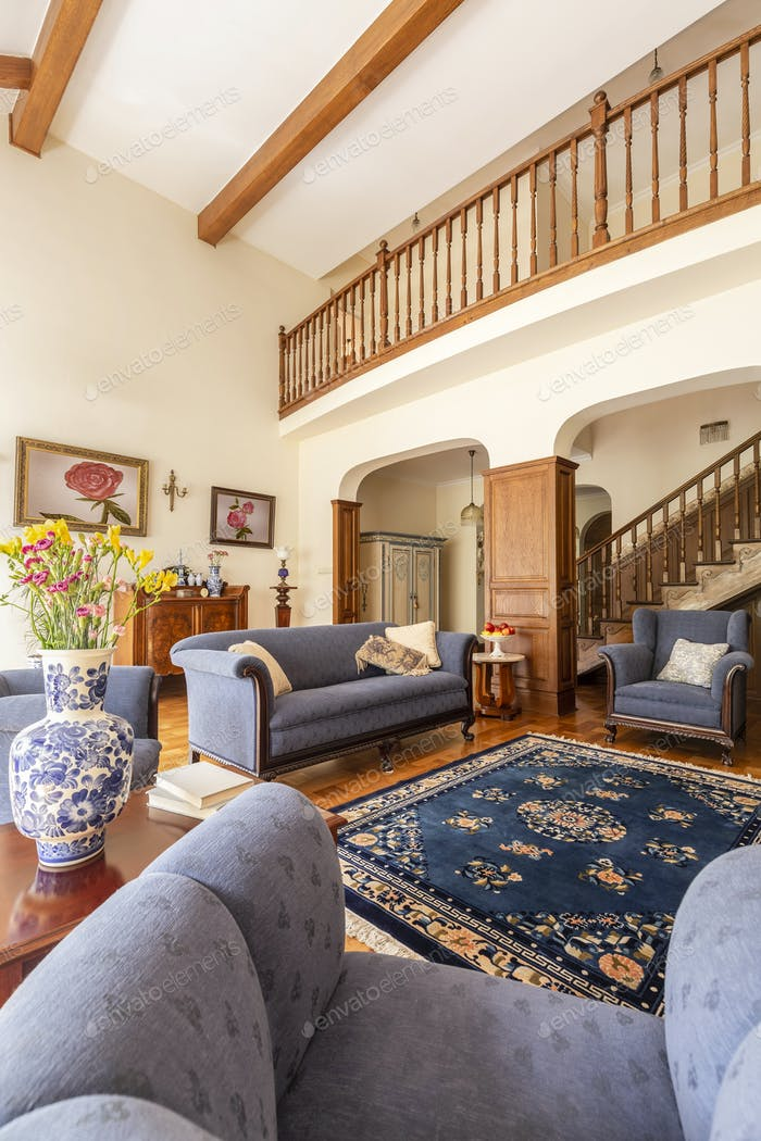 Real Photo Of A Living Room Interior With Blue Sofa Rug Porcel
